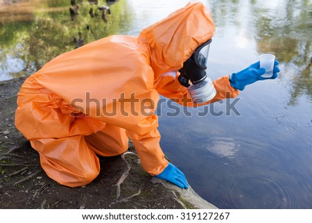 Expert checking radioactivity in water - stock photo