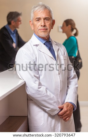 Expert male doctor face expression in hospital waiting room. - stock photo