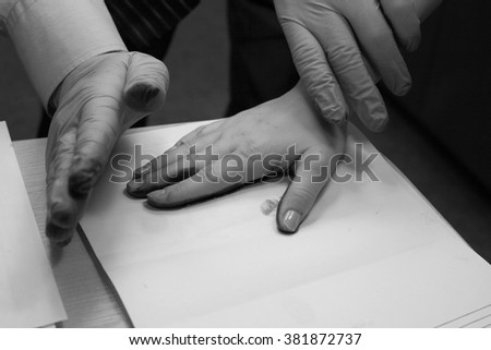 Expert takes fingerprints. investigation of the crime. - stock photo