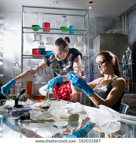 Experts analyze the drug in the chemical laboratory - stock photo