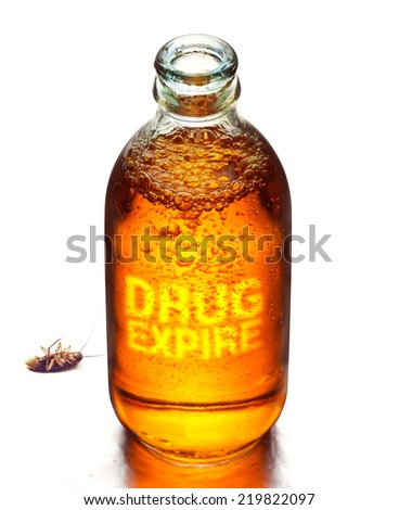 Expired drug and dead cockroach on white background, vibrant color concept - stock photo
