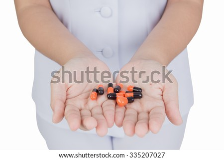 Expired drug on hand of doctor - stock photo