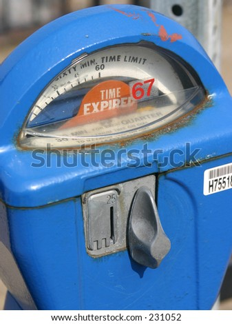 Expired parking meter. - stock photo