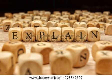 EXPLAIN word written on wood block - stock photo