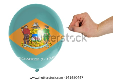 exploding balloon colored in flag of us state of delaware - stock photo