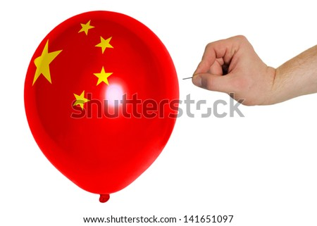 exploding balloon colored in national flag of china - stock photo