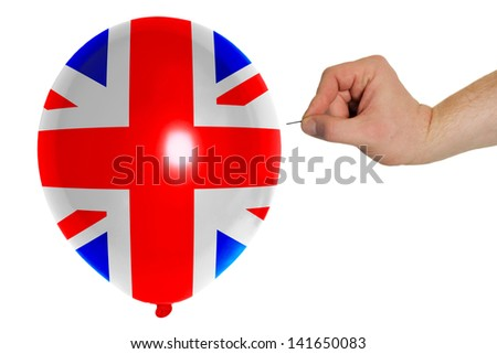 exploding balloon colored in national flag of uk - stock photo