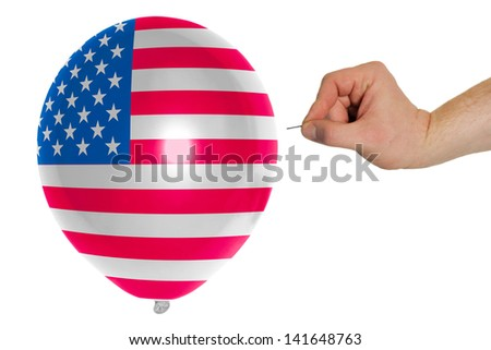 exploding balloon colored in national flag of us - stock photo