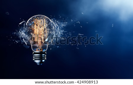 Exploding light bulb on a blue background - 3D Rendering - stock photo