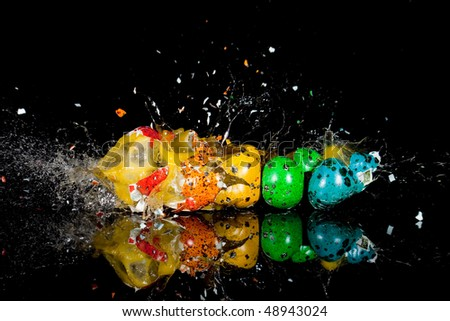 exploding multicolored quail eggs - stock photo