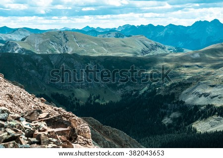 Exploration and Backpacking Leads you to Far off Places Ice Lake Basin High altitude surrounding View dramatic Deep Valley of San Juan Mountains near Silverton , Colorado - stock photo