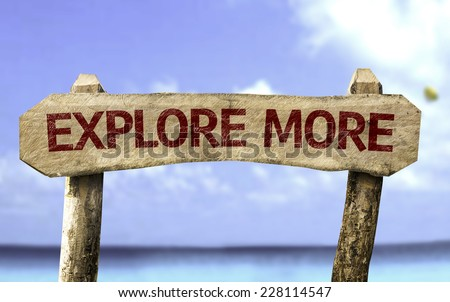 Explore More wooden sign with a beach on background - stock photo