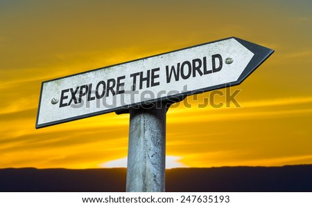 Explore the World sign with a sunset background - stock photo