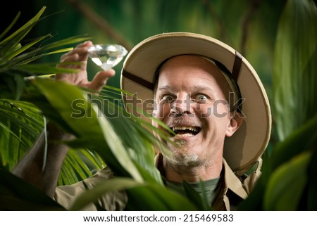 Explorer finding a huge precious gem in the jungle wilderness - stock photo
