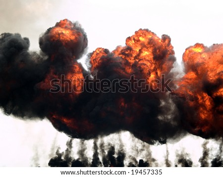 Explosion fire and smoke rising high on sky - stock photo