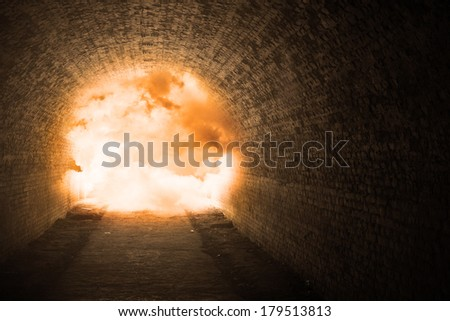 Explosion inside the long underground tunnel - stock photo