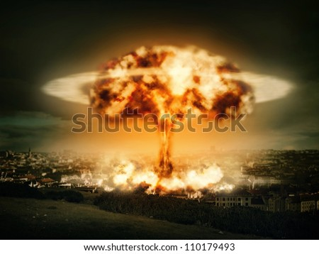 Explosion of nuclear bomb over city - stock photo