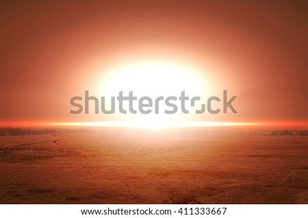 Explosion of nuclear bomb over land - stock photo