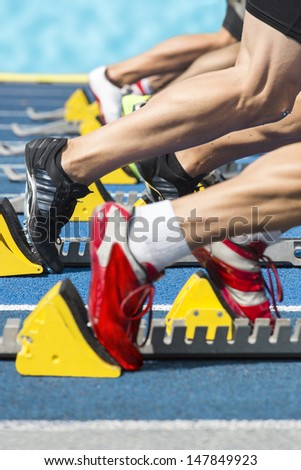 Explosive start of a athletics race out of the blocks - stock photo