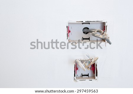 Exposed wiring in an unfinished plug socket - UK - stock photo