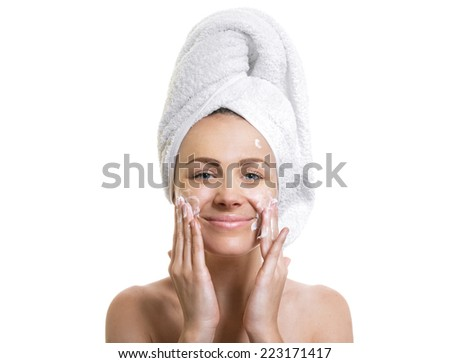 Expresive female after bathing putting cream or moisturize on his face ,isolated on white  - stock photo