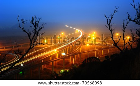 express highway in fog at night - stock photo
