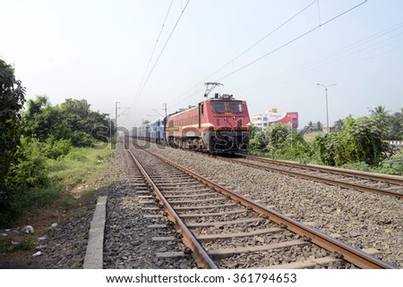 Express train pulled by locomotive Engine coming toward Howrah after overnight journey on November 13, 2015 in Howrah, India. - stock photo