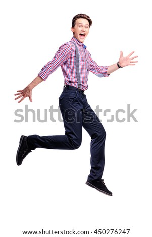 Expressing jump. Full length studio portrait of handsome young dancing man. Isolated on white. - stock photo