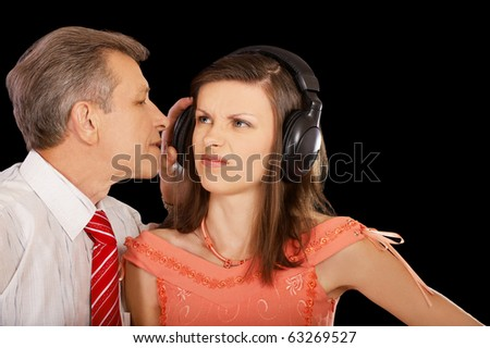 expression family portrait of senior man pulling of headphone from offended girl's head - stock photo