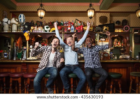 Expression fans at a bar - stock photo