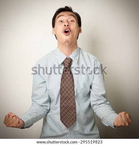 expression very happy successful gesturing business man, isolated on white. - stock photo