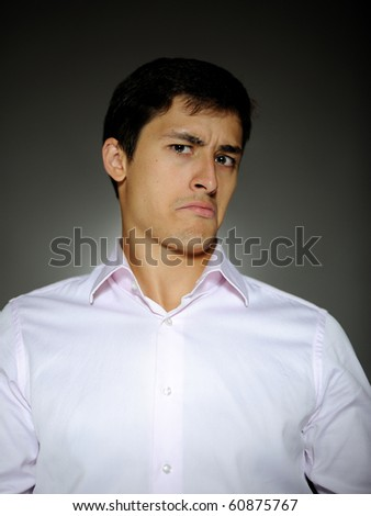 Expressions Handsome business man in funny shirt surprise - stock photo