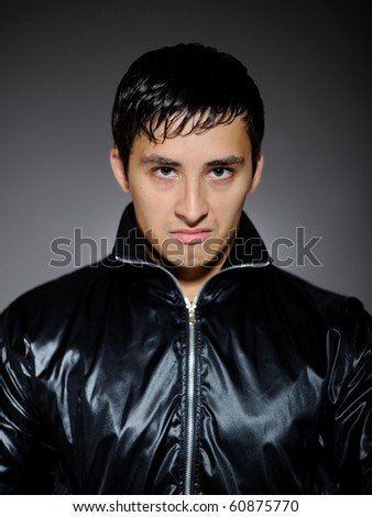 Expressions. Young aggressive gand leader man - stock photo