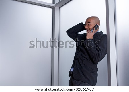 Expressive businessman talking on his cell phone, happy and excited. - stock photo