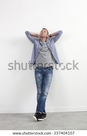 expressive casual man concept - relaxed middle age man standing against white wall with outstretched arms expressing imagination,white background - stock photo