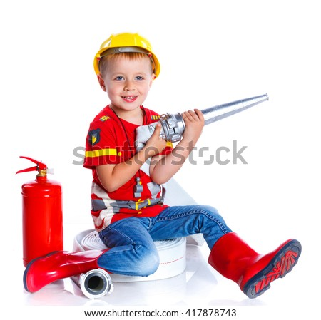 Expressive cute toddler boy with fireman's outfit on. Isolated on the white background - stock photo