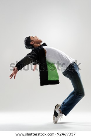expressive dance move where the modern dancer bends backwards and shows his emotions - stock photo