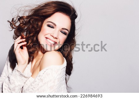Expressive portrait of a beautiful brunette girl in the studio - stock photo