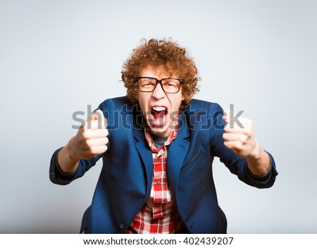 expressive portrait of a man screaming, isolated on background - stock photo