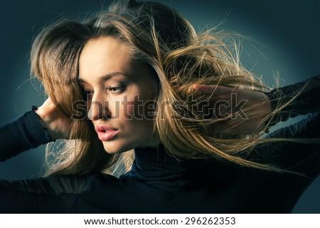 Expressive portrait of a woman. Studio photo. - stock photo