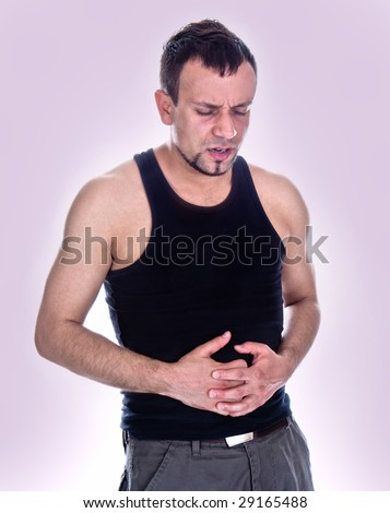 expressive portrait of man who has stomch pain - stock photo