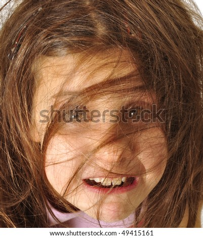 Expressive portrait of tousled girl - stock photo