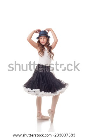 Expressive young ballerina isolated on white - stock photo