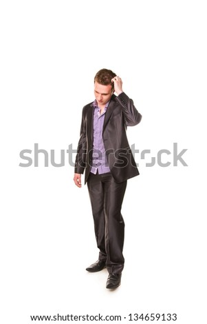 Expressive young businessman frustated thinking isolated on white - stock photo
