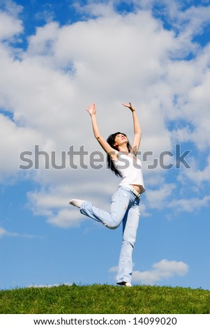 expressive young woman is jumping - stock photo