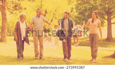 Extended family having fun in the park - stock photo