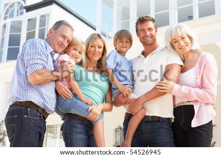 Extended Family Outside Modern House - stock photo