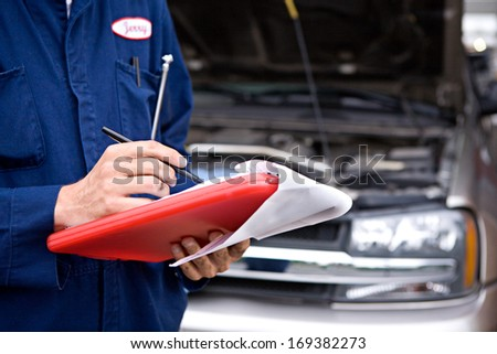 Extensive series of a woman who has taken her car to the auto service garage, and the mechanic who works on her truck. - stock photo