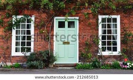 Exterior and Front Door of a Beautiful Old House  - stock photo