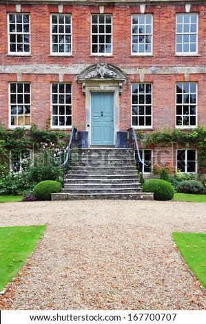 Exterior and Pathway of a Beautiful Georgian Era English Mansion - stock photo